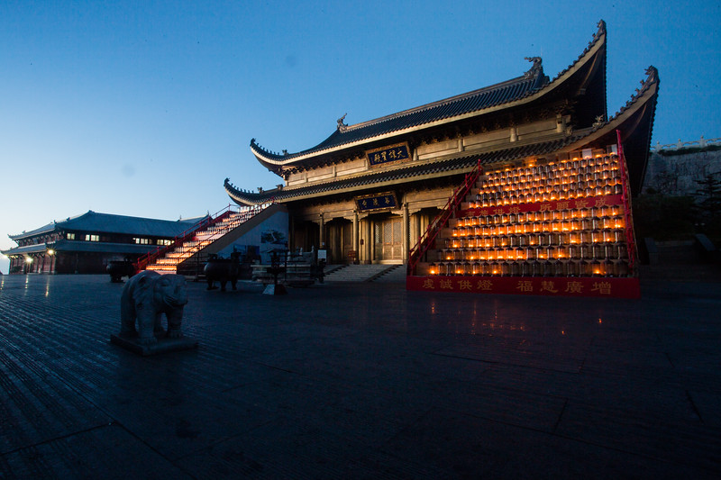 A candle- and sunrise-lit temple on the top of Emeishan in Sichuan, China.