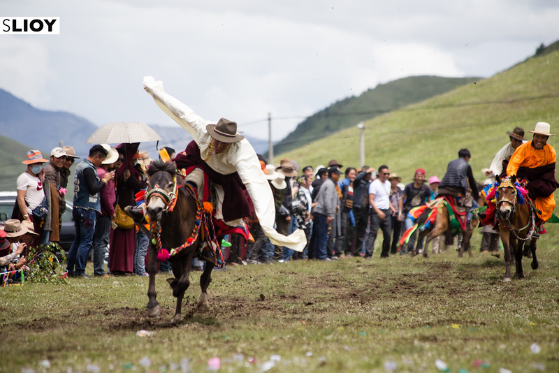 A Tibetan rider performing during the Tagong Horse Festival in Western Sichuan, China.