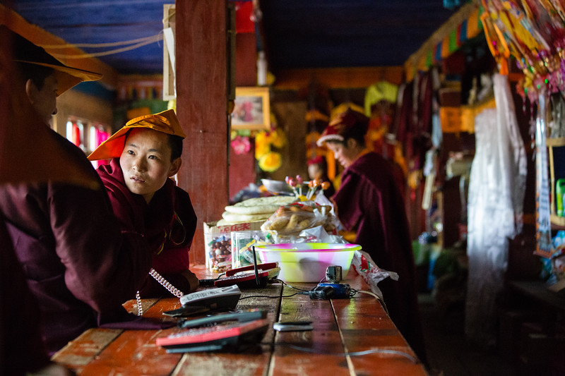 Nuns shopping at a small store in the Yarchengar Tibetan Buddhist Nunnery in Sichuan, China.