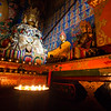 Yak butter candles lighting an altar inside Mindroling Monastery in the Yarlung Tsangpo valley of the U region of Tibet.