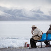 Two Tibetan men in front of the landscape of Namtso Lake in the U region of Tibet.