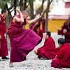 Monks debate inside the Shetekhang debating courtyard of Samye Monastery in the Lhoka Prefecture of Tibet.