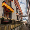A worshipper circumambulates Demo Monastery in Eastern Tibet.