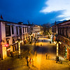 The illuminated streets of the Barkhor area of Lhasa, Tibet during the blue hour.
