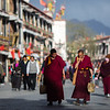 Monks circle the Barkhor kora in Lhasa, Tibet.