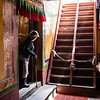 A worshipper exits the inner chapel of the Tespak Lakhang in Lhasa, Tibet.