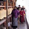 A pilgrim circumambulates the prayer wheel circuit of Ramoche Temple in Lhasa, Tibet.