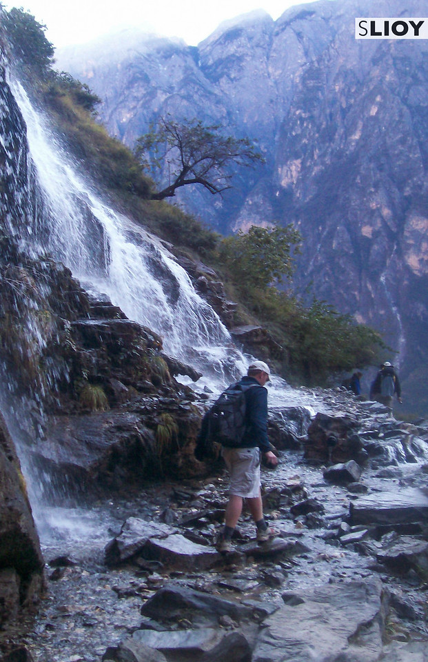 Crossing a waterfall in Tiger Leaping Gorge in China's Yunnan Province