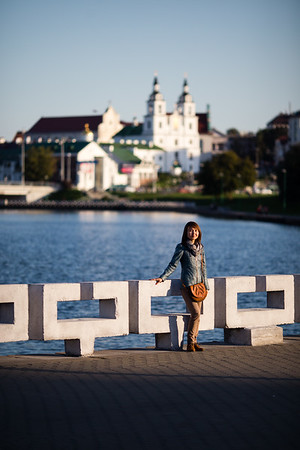 A female tourist poses near the Svislach River in Minsk, Belarus.