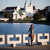 A female tourist poses near the Svislach River in Minsk, Belarus.