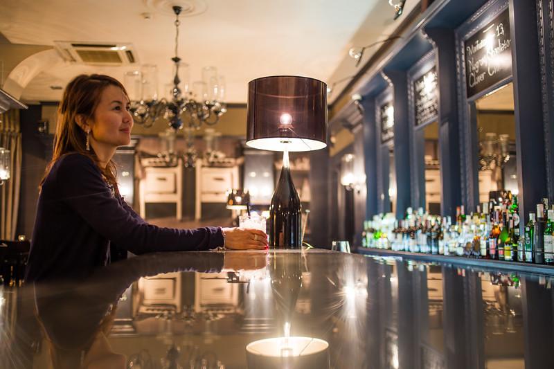 A female tourist inside the bar of the Grand Cafe of Minsk, Belarus.