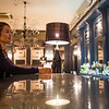 A female tourist inside the bar of the Grand Cafe of Minsk, Belarus.