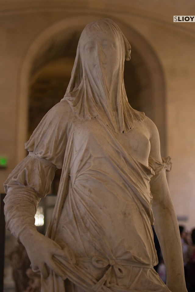vieled woman sculpture louvre