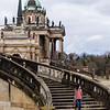 A female tourist walks down the steps of a palace at Sanssouci in Potsdam, Germany.