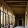 A female tourists poses in the arcades of a palace at Sanssouci in Potsdam, Germany.