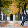 A female tourist sitting under the trees in the Jardin de Isabella 2 in Aranjuez, Spain.