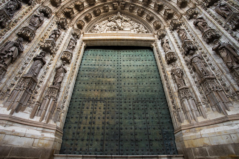 Gothic architecture and door of the Catedral de Sevilla in Seville, Spain.