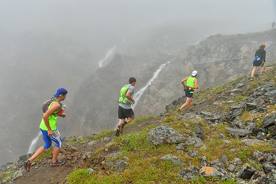 July 26, 2014: 31st Annual Crow Pass Crossing, sponsored by the University of Alaska Anchorage SAA/Milers Booster Club. The race is approximately 24 miles along the Crow Pass Trail from its start near Girdwood to the Eagle River Nature Center at the end of Eagle River Road. The total gradient is 5,959 feet, with a peak elevation gain of 3,888 feet. © 2014 Sam Wasson/UAA