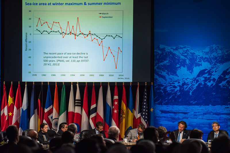 August 31, 2015: Attendees take notes as Dr. John Holdren, Assistant to the President for Science and Technology, addresses the opening plenary of the Global Leadership in the Arctic Cooperation, Innovation, Engagement & Resilience conference.