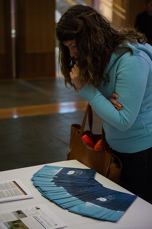 September 1, 2015: An participant looks over materials for the Picture of the Arctic event.
