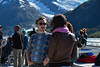 September 1, 2015: Department of State Public Affairs Officer Ether Falcon Bell and First Five United States Arctic Youth Ambassador Griffin Plush chat during the glacier cruise in Portage during the afternoon workshop.