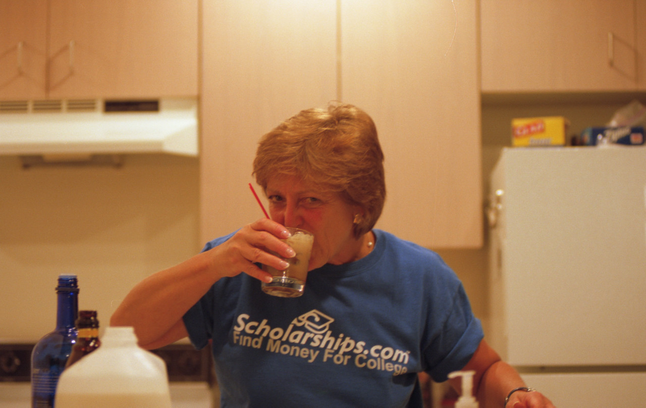 Mom making sure my drink is ok.