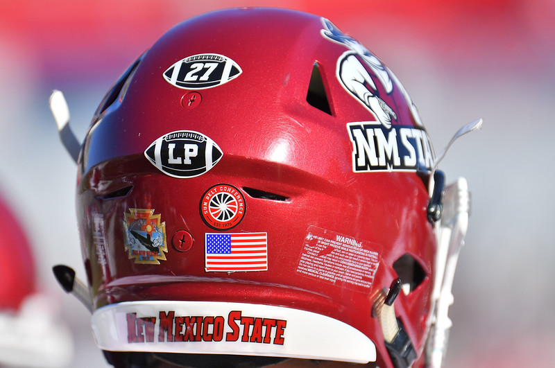 """December 29, 2017; Tucson, AZ, USA;  A general view shows """"27"""" and """"LP"""" helmet stickers memorializing All-American and College Football Hall of Fame running back Pervis Atkins, and Lori Paulson during the NOVA Home Loans Arizona Bowl at Arizona Stadium in Tucson, Ariz. Atkins passed away just prior to the bowl game while Paulson, an Aggie football booster, succumbed to pancreatic cancer in 2016.  Photo by Sam Wasson/bleedCrimson.net"""