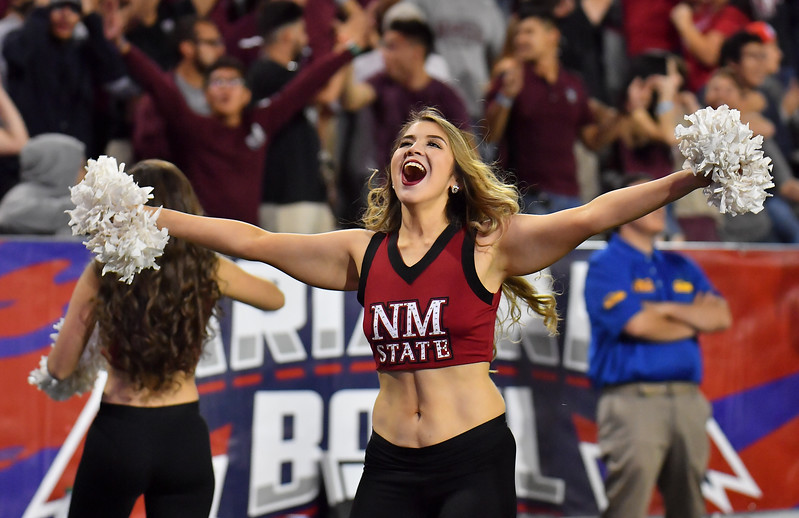 December 29, 2017; Tucson, AZ, USA;  A New Mexico State Aggies cheerleader celebrates after a missed field goal by Utah State Aggies place kicker Dominik Eberle (62) in overtime during the NOVA Home Loans Arizona Bowl at Arizona Stadium in Tucson, Ariz.  Photo by Sam Wasson/bleedCrimson.net
