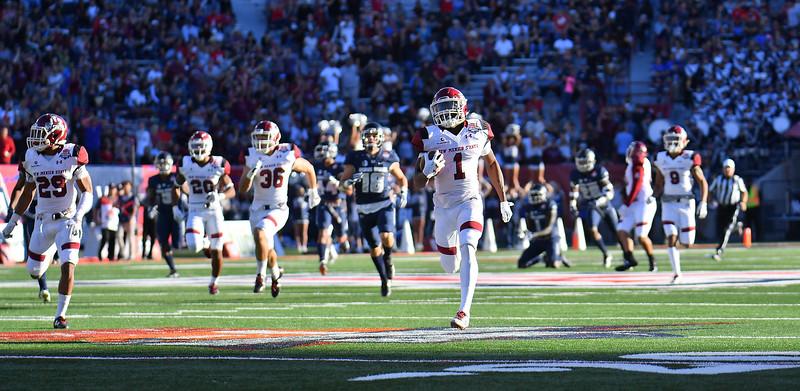 December 29, 2017; Tucson, AZ, USA;  New Mexico State Aggies running back Jason Huntley (1) returns a kickoff for a touchdown against the Utah State Aggies during the NOVA Home Loans Arizona Bowl at Arizona Stadium in Tucson, Ariz.  Photo by Sam Wasson/bleedCrimson.net