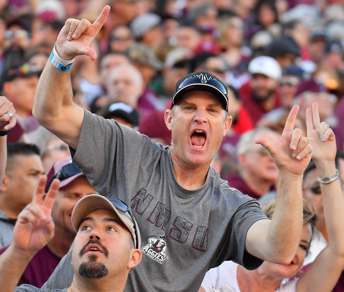 December 29, 2017; Tucson, AZ, USA;  New Mexico State Aggies fans cheer during the team's game against the Utah State Aggies during the NOVA Home Loans Arizona Bowl at Arizona Stadium in Tucson, Ariz.  Photo by Sam Wasson/bleedCrimson.net