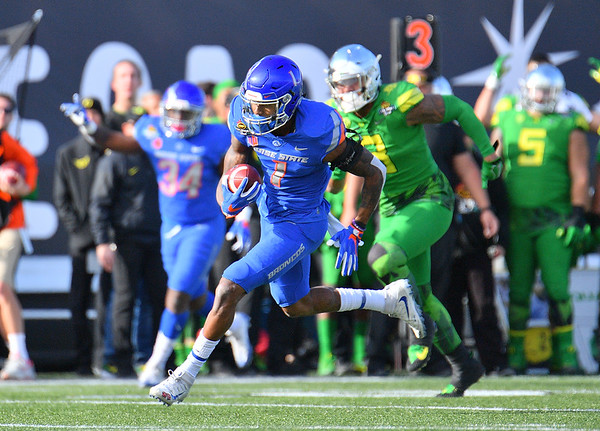 Dec 16, 2017; Las Vegas, NV, USA;  Boise State Broncos wide receiver Cedrick Wilson (1) runs toward the endzone after making a catch against the Oregon Ducks during their game at the 26th Las Vegas Bowl at Sam Boyd Stadium.  Photo Credit: Sam Wasson for the Portland Tribune