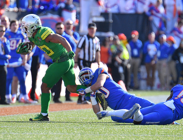 Dec 16, 2017; Las Vegas, NV, USA;  Oregon Ducks wide receiver Johnny Johnson III (80) is tackled by Boise State Broncos safety Kekoa Nawahine (10) during their game at the 26th Las Vegas Bowl at Sam Boyd Stadium.  Photo Credit: Sam Wasson for the Portland Tribune