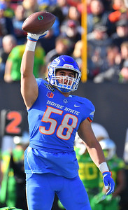 Dec 16, 2017; Las Vegas, NV, USA;  Boise State Broncos linebacker Tyson Maeva (58) celebrates after recovering a fumble against the Oregon Ducks during their game at the 26th Las Vegas Bowl at Sam Boyd Stadium.  Photo Credit: Sam Wasson for the Portland Tribune