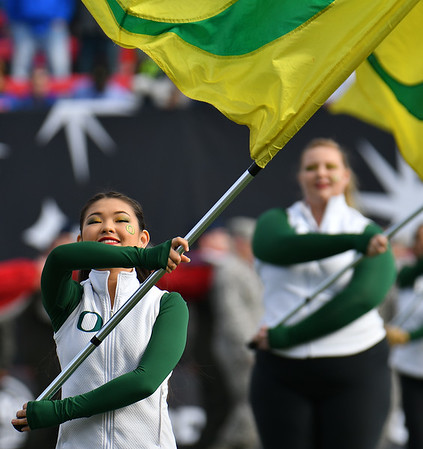 Dec 16, 2017; Las Vegas, NV, USA;  Members of the Oregon Ducks color guard perform before the team's game against the Boise State Broncos at the 26th Las Vegas Bowl at Sam Boyd Stadium.  Photo Credit: Sam Wasson for the Portland Tribune