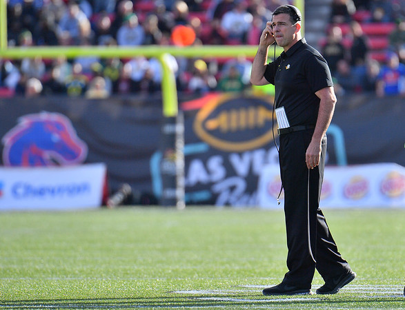 Dec 16, 2017; Las Vegas, NV, USA;  Oregon Ducks head coach Mario Cristobal stands on the field during their game against the Boise State Broncos at the 26th Las Vegas Bowl at Sam Boyd Stadium. Boise State won 38-28.  Photo Credit: Sam Wasson for the Portland Tribune