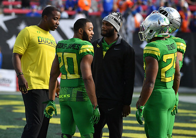 Dec 16, 2017; Las Vegas, NV, USA;  Oregon Ducks running back Royce Freeman (C) stands on the field before the team's game against the Boise State Broncos at the 26th Las Vegas Bowl at Sam Boyd Stadium.  Photo Credit: Sam Wasson for the Portland Tribune