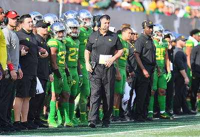 Dec 16, 2017; Las Vegas, NV, USA;  Oregon Ducks head coach Mario Cristobal (C) looks on during their game against the Boise State Broncos at the 26th Las Vegas Bowl at Sam Boyd Stadium. Boise State won 38-28.  Photo Credit: Sam Wasson for the Portland Tribune