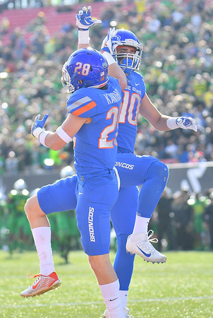 Dec 16, 2017; Las Vegas, NV, USA;  Boise State safeties  Kekaula Kaniho (28) and Kekoa Nawahine (10) celebrate after a Kaniho returned an interception for a touchdown during their game against the Oregon Ducks at the 26th Las Vegas Bowl at Sam Boyd Stadium.  Photo Credit: Sam Wasson for the Portland Tribune