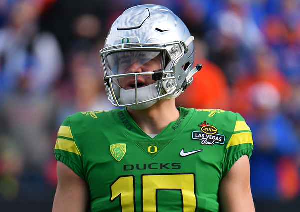 Dec 16, 2017; Las Vegas, NV, USA;  Oregon Ducks quarterback Justin Herbert (10) stands on the field during their game against the Boise State Broncos at the 26th Las Vegas Bowl at Sam Boyd Stadium.  Photo Credit: Sam Wasson for the Portland Tribune