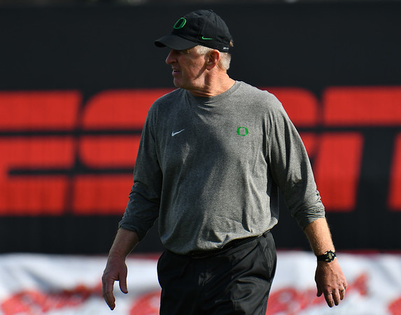 Dec 16, 2017; Las Vegas, NV, USA;  Oregon Ducks defensive coordinator Jim Leavitt stands on the field during warmups before their game against the Oregon Ducks at the 26th Las Vegas Bowl at Sam Boyd Stadium.  Photo Credit: Sam Wasson for the Portland Tribune