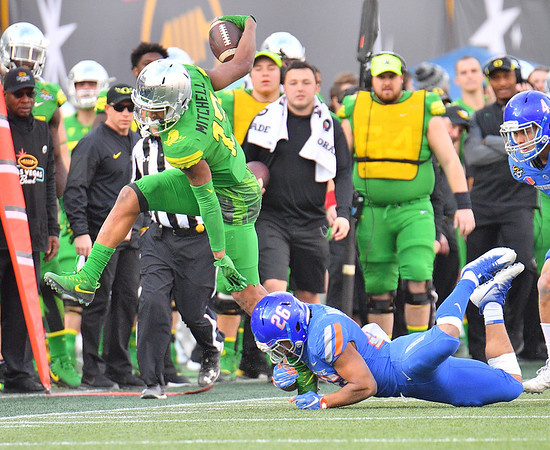Dec 16, 2017; Las Vegas, NV, USA;  Oregon Ducks wide receiver Dillon Mitchell (13) is tackled by Boise State Broncos cornerback Avery Williams (26) during their game at the 26th Las Vegas Bowl at Sam Boyd Stadium. Boise State won 38-28.  Photo Credit: Sam Wasson for the Portland Tribune