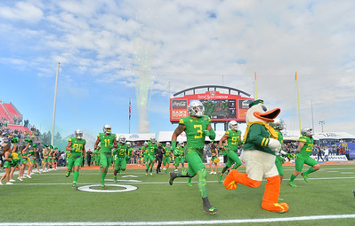 Dec 16, 2017; Las Vegas, NV, USA;  The Oregon Ducks football team takes the field before their game against the Boise State Broncos at the 26th Las Vegas Bowl at Sam Boyd Stadium.  Photo Credit: Sam Wasson for the Portland Tribune