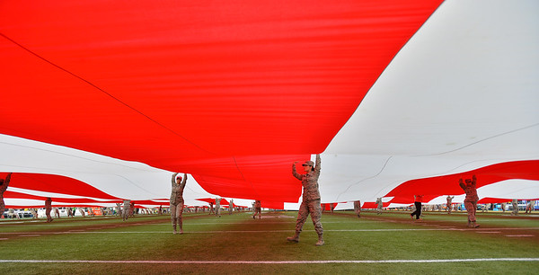 Dec 16, 2017; Las Vegas, NV, USA;  Members of the military hold up a large American flag before a game between the Boise State Broncos and the Oregon Ducks at the 26th Las Vegas Bowl at Sam Boyd Stadium.  Photo Credit: Sam Wasson for the Portland Tribune