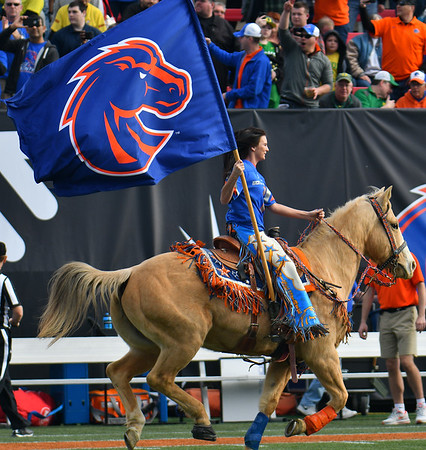 Dec 16, 2017; Las Vegas, NV, USA;  Boise State Bronco Girl Brianna Flansburg rides her horse Cassie onto the field before a game between the Boise State Broncos and the Oregon Ducks at the 26th Las Vegas Bowl at Sam Boyd Stadium.  Photo Credit: Sam Wasson for the Portland Tribune