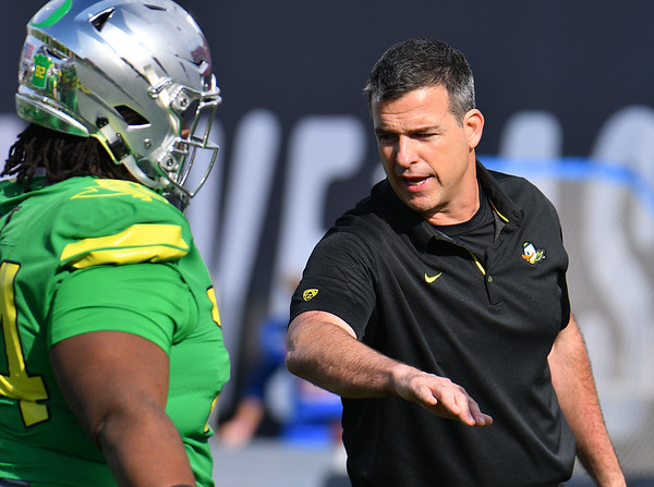 Dec 16, 2017; Las Vegas, NV, USA;  Oregon Ducks head coach Mario Cristobal stands on the field during warmups before their game against the Boise State Broncos at the 26th Las Vegas Bowl at Sam Boyd Stadium.  Photo Credit: Sam Wasson for the Portland Tribune