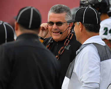 LAS CRUCES, NEW MEXICO - SEPTEMBER 25:  Head coach Todd Graham of the Hawaii Rainbow Warriors talks with officials before the start of his team's game against the New Mexico State Aggies at Aggie Memorial Stadium on September 25, 2021 in Las Cruces, New Mexico.  (Photo by Sam Wasson/bleedCrimson.net)