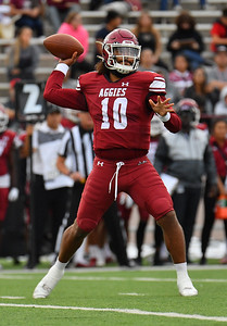 LAS CRUCES, NEW MEXICO - SEPTEMBER 25:  Quarterback Jonah Johnson #10 of the New Mexico State Aggies passes against the Hawaii Rainbow Warriors in the first half of their game at Aggie Memorial Stadium on September 25, 2021 in Las Cruces, New Mexico.  (Photo by Sam Wasson/bleedCrimson.net)