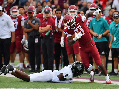 LAS CRUCES, NEW MEXICO - SEPTEMBER 25:  Defensive back Eugene Ford #8 of the Hawaii Rainbow Warriors tackles wide receiver Andre Bodison #11 of the New Mexico State Aggies in the first half of their game at Aggie Memorial Stadium on September 25, 2021 in Las Cruces, New Mexico.  (Photo by Sam Wasson/bleedCrimson.net)