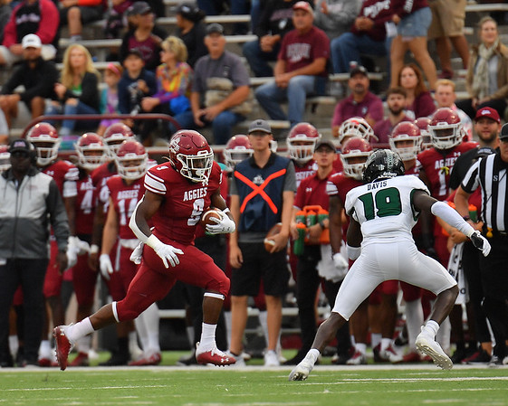 LAS CRUCES, NEW MEXICO - SEPTEMBER 25:  Running back Juwaun Price #9 of the New Mexico State Aggies runs against defensive back Quentin Frazier #19 of the Hawaii Rainbow Warriors in the first half of their game at Aggie Memorial Stadium on September 25, 2021 in Las Cruces, New Mexico.  (Photo by Sam Wasson/bleedCrimson.net)