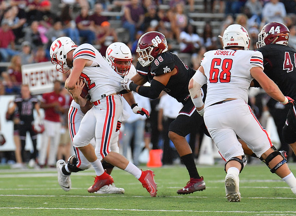 LAS CRUCES, NEW MEXICO - OCTOBER 05, 2019:  Defensive lineman Xander Yarberough #88 of the New Mexico State Aggies sacks quarterback Stephen Calvert #12 of the Liberty Flames during their game at Aggie Memorial Stadium on October 05, 2019 in Las Cruces, New Mexico. The Flames defeated the Aggies 20-13.  (Photo by Sam Wasson)